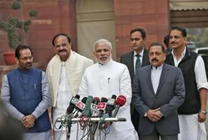 Modi speaks to the media upon his arrival on the opening day of the winter session of the Indian Parliament in New Delhi